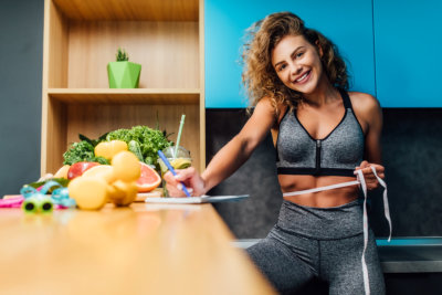 woman in sportswear and healthy foods