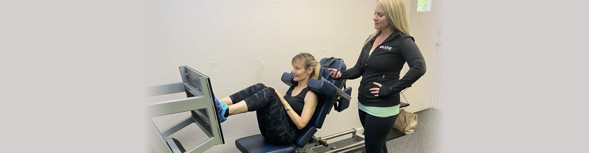 woman working out with trainer